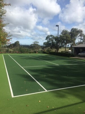 large tennis court in a lawn